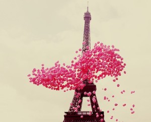 pink ballons around eiffel tower